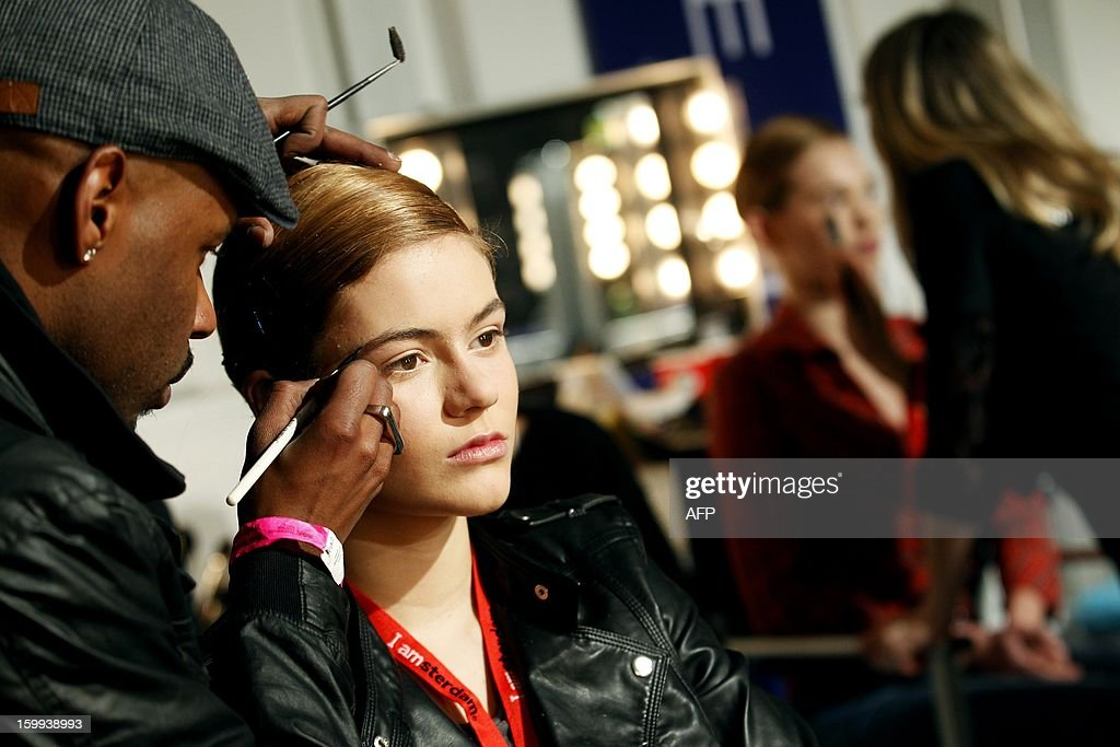 Models getting their make-up on prior to the opening of the 18th edition of the Amsterdam Fashion Week in Amsterdam on January 23, 2013. The Fashion Week runs until January 27. netherlands out