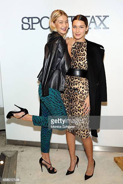 Models Gigi Hadid and Bella Hadid attend Sportmax and Teen Vogue Celebrate The Fall/Winter 2014 Collection at Sportmax on October 28 2014 in New York...