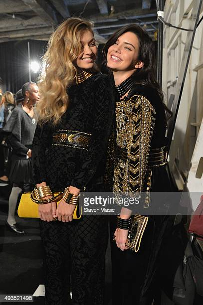 Models Gigi Hadid and Kendall Jenner pose backstage at the BALMAIN X HM Collection Launch at 23 Wall Street on October 20 2015 in New York City