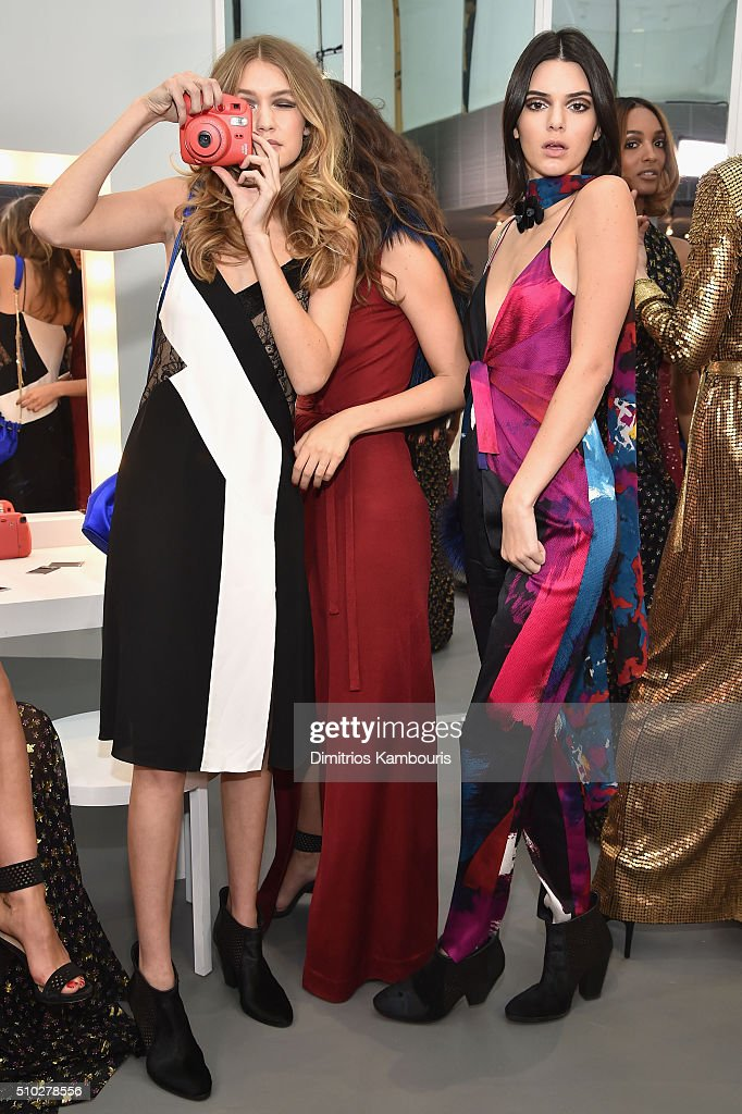 Models <a gi-track='captionPersonalityLinkClicked' href=/galleries/search?phrase=Gigi+Hadid&family=editorial&specificpeople=9198520 ng-click='$event.stopPropagation()'>Gigi Hadid</a> (L) and <a gi-track='captionPersonalityLinkClicked' href=/galleries/search?phrase=Kendall+Jenner&family=editorial&specificpeople=2786662 ng-click='$event.stopPropagation()'>Kendall Jenner</a> pose wearing Diane Von Furstenberg Fall 2016 during New York Fashion Week on February 14, 2016 in New York City.