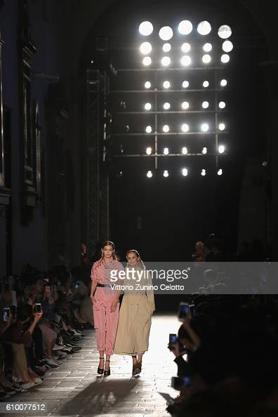 Models Gigi Hadid and Lauren Hutton walk the runway at the Bottega Veneta show during Milan Fashion Week Spring/Summer 2017 on September 24 2016 in...
