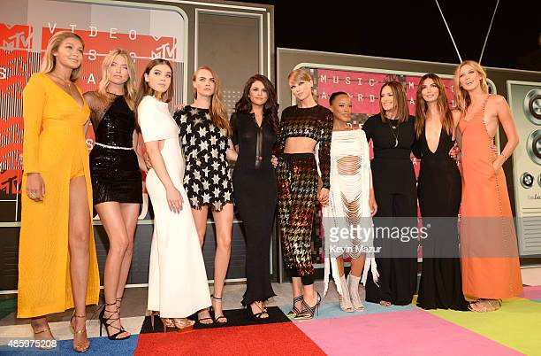 Models Gigi Hadid and Martha Hunt actress Hailee Steinfeld model Cara Delevingne recording artists Selena Gomez and Taylor Swift actress Serayah...
