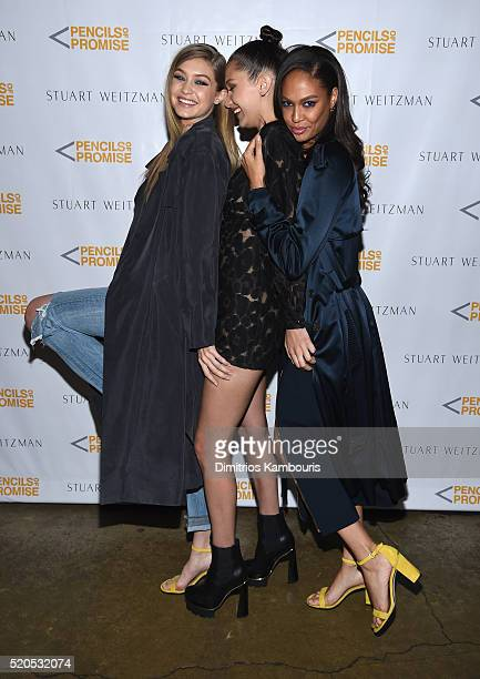 Models Gigi Hadid Bella Hadid and Joan Smalls attend as Stuart Weitzman launches its partnership with Pencils Of Promise at Sadelle's on April 11...