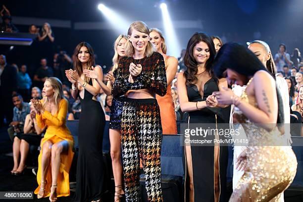 Models Gigi Hadid Lily Aldridge Martha Hunt recording artist Taylor Swift model Karlie Kloss actress/singer Selena Gomez and actress Serayah applaud...