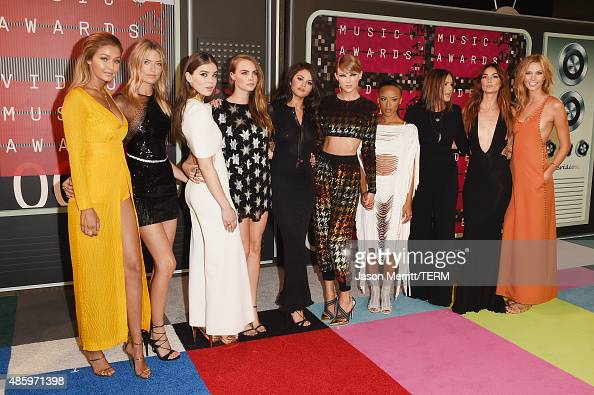 Models Gigi Hadid Martha Hunt actress Hailee Steinfeld model Cara Delevingne actress Selena Gomez musician Taylor Swift model Serayah actress Mariska...