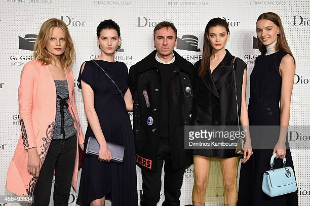 Models Hanne Gaby Odiele and Katlin Aas Fashion designer Raf Simons and models Diana Moldovan and Irina Liss attend the Guggenheim International Gala...