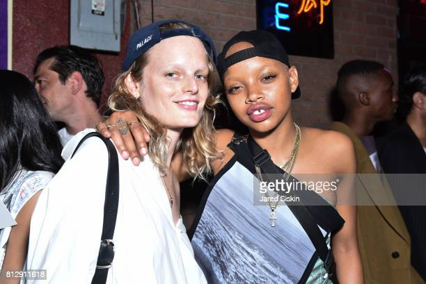 Models Hanne Gaby Odiele and Slick Woods attend Raf Simons Front Row during NYFW Men's at Golden Sun Life Day Care on July 11 2017 in New York City