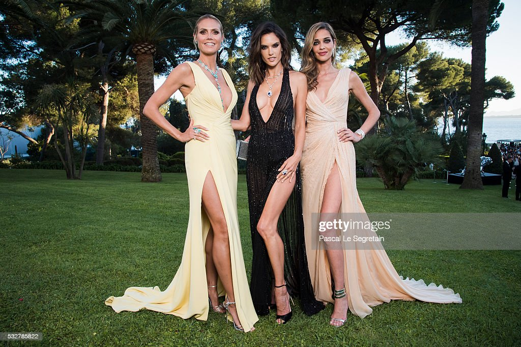 Models Heidi Klum, Alessandra Ambrosio and Ana Beatriz Barros pose for photographs at the amfAR's 23rd Cinema Against AIDS Gala at Hotel du Cap-Eden-Roc on May 19, 2016 in Cap d'Antibes, France.