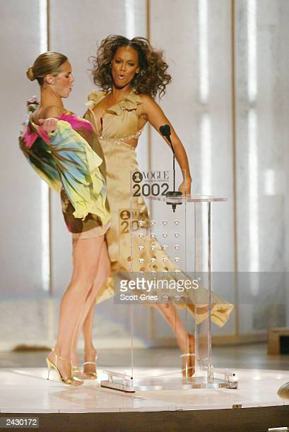 Models Heidi Klum and Tyra Banks bump chests onstage at the 2002 VH1 Vogue Fashion Awards at Radio City Music Hall in New York City 10/15/02 Photo by...