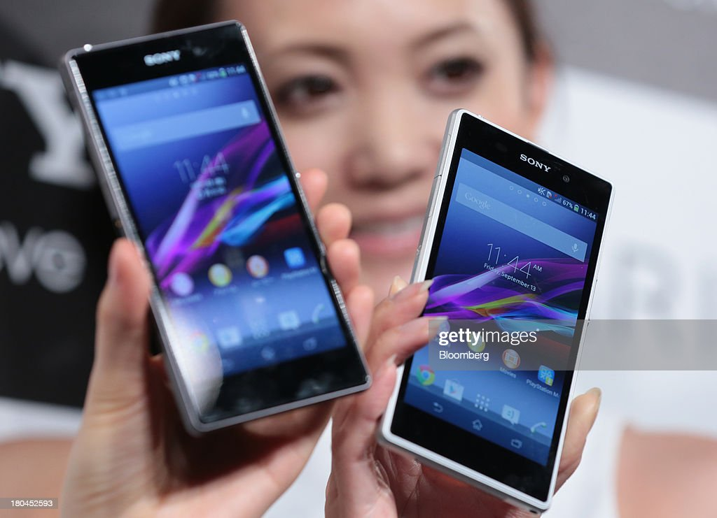 Models hold up Sony Corp. Xperia Z1 smartphones during a news conference in Tokyo, Japan, on Friday, Sept. 13, 2013. Sony Corp. is betting its Xperia Z1 handset will propel it to No. 3 in the smartphone market, leaping from seventh place by vaulting past competitors such as LG Electronics Inc. and Lenovo Group Ltd. Photographer: Yuriko Nakao/Bloomberg via Getty Images