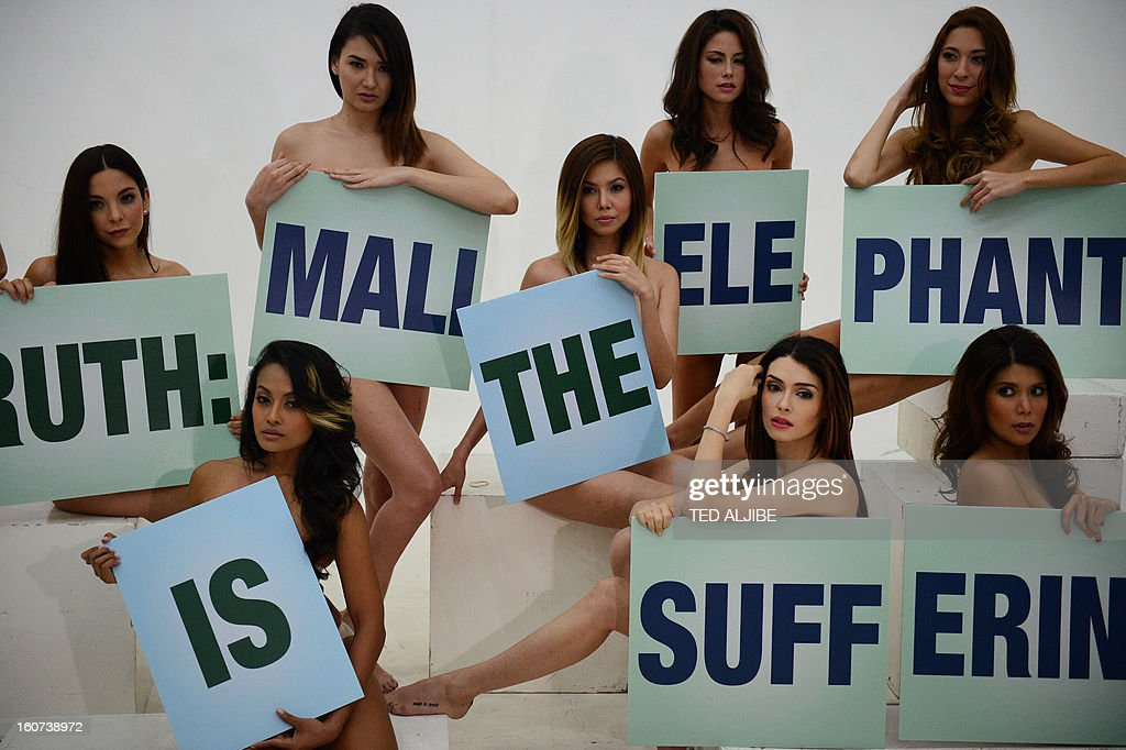 Models holding placards pose during a photo shoot for a new advertisement for People for the Ethical Treatment of Animals (PETA) at a studio in Manila on February 5, 2013, as part of PETA's online campaign for the transfer of an elderly elephant named Mali from Manila Zoo to a sanctuary in Thailand. 'Mali' is the star at Manila's zoo but also the focus of a campaign alleging animal cruelty that has united the country's powerful bishops, global pop stars and a Nobel laureate. PETA began campaigning for Mali, who is now aged 38, to be removed from the zoo seven years ago.