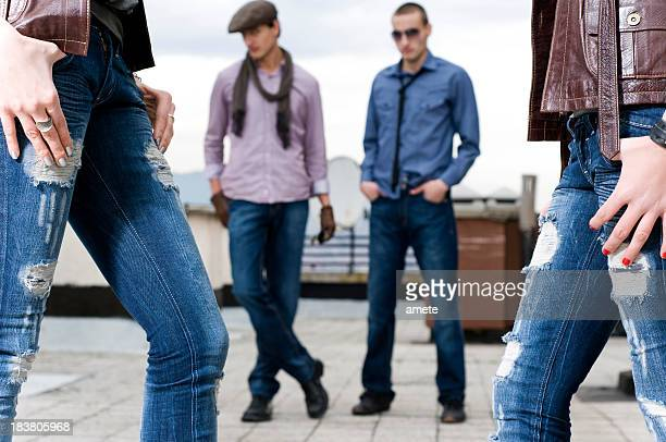 Models in different styles of blue jeans