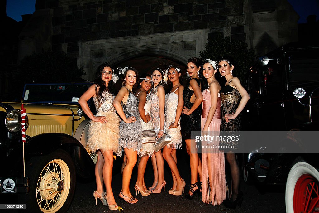 Models in period costumes pose during Baz Luhrmann & Gold Coast Int'l Film Festival host 'The Great Gatsby' on May 8, 2013 in Port Washington, New York.
