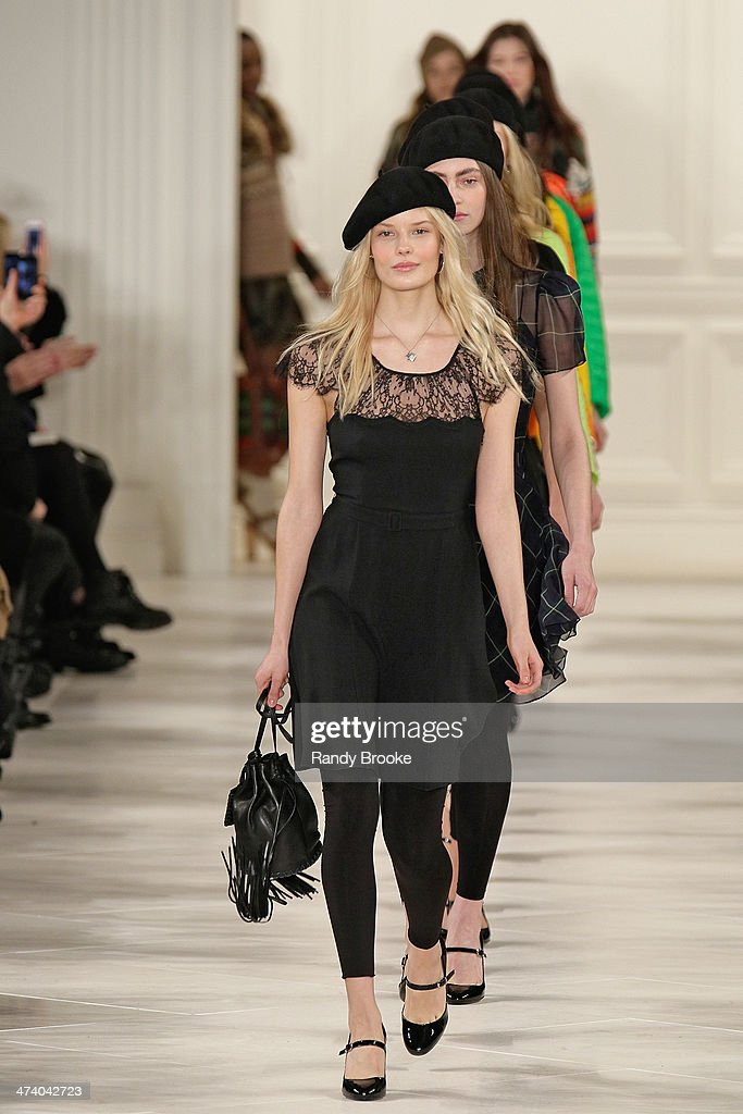 Models in the finale walk the runway at Ralph Lauren during Mercedes-Benz Fashion Week Fall 2014 at St. John's Center Studios on February 13, 2014 in New York City.