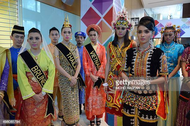 Models in various traditional costumes of ASEAN members are pictured before the opening ceremony of the 27th Association of Southeast Asian Nations...
