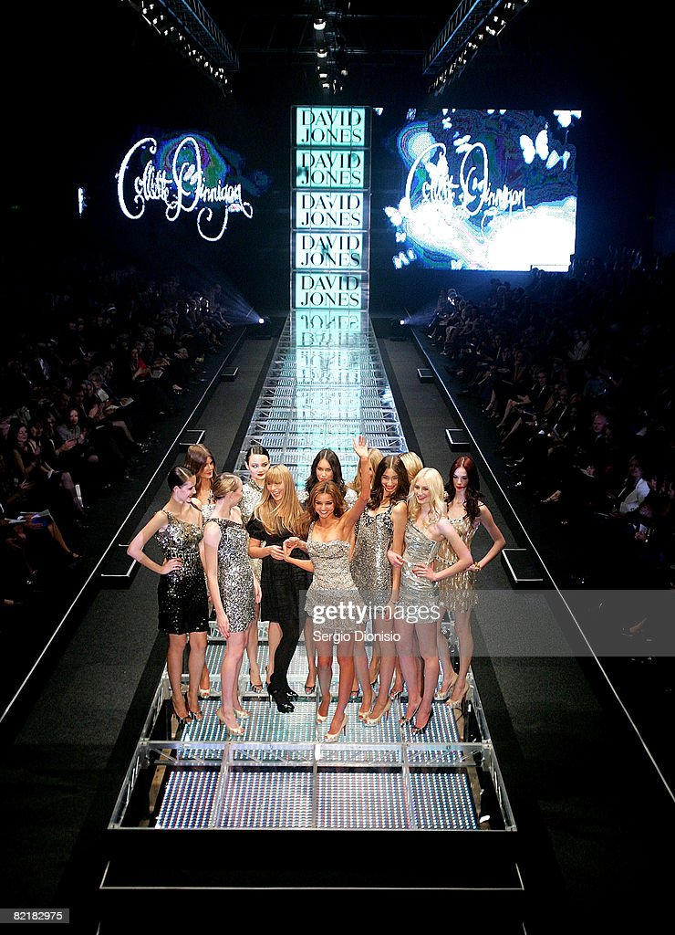 Models including Miranda Kerr showcase designs by Collette Dinnigan alongside the designer herself at the finale on the catwalk at the finale of the...