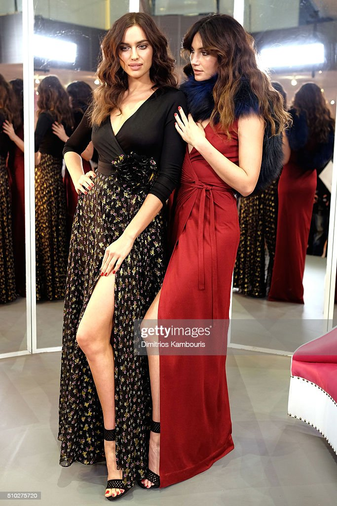 Models Irina Shayk (L) and <a gi-track='captionPersonalityLinkClicked' href=/galleries/search?phrase=Lily+Aldridge&family=editorial&specificpeople=2110490 ng-click='$event.stopPropagation()'>Lily Aldridge</a> pose wearing Diane Von Furstenberg Fall 2016 during New York Fashion Week on February 14, 2016 in New York City.
