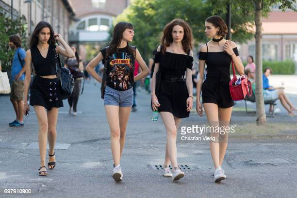 Models is seen outside Malibu 1992 during Milan Men's Fashion Week Spring/Summer 2018 on June 19 2017 in Milan Italy