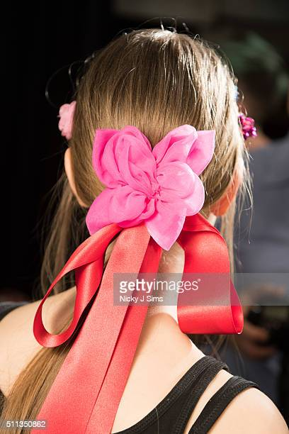 A models is seen wearing a bow backstage prior to the Ryan Lo show on day 1 of London Fashion Week Autumn Winter 2016 at BFC Showspace on February 19...
