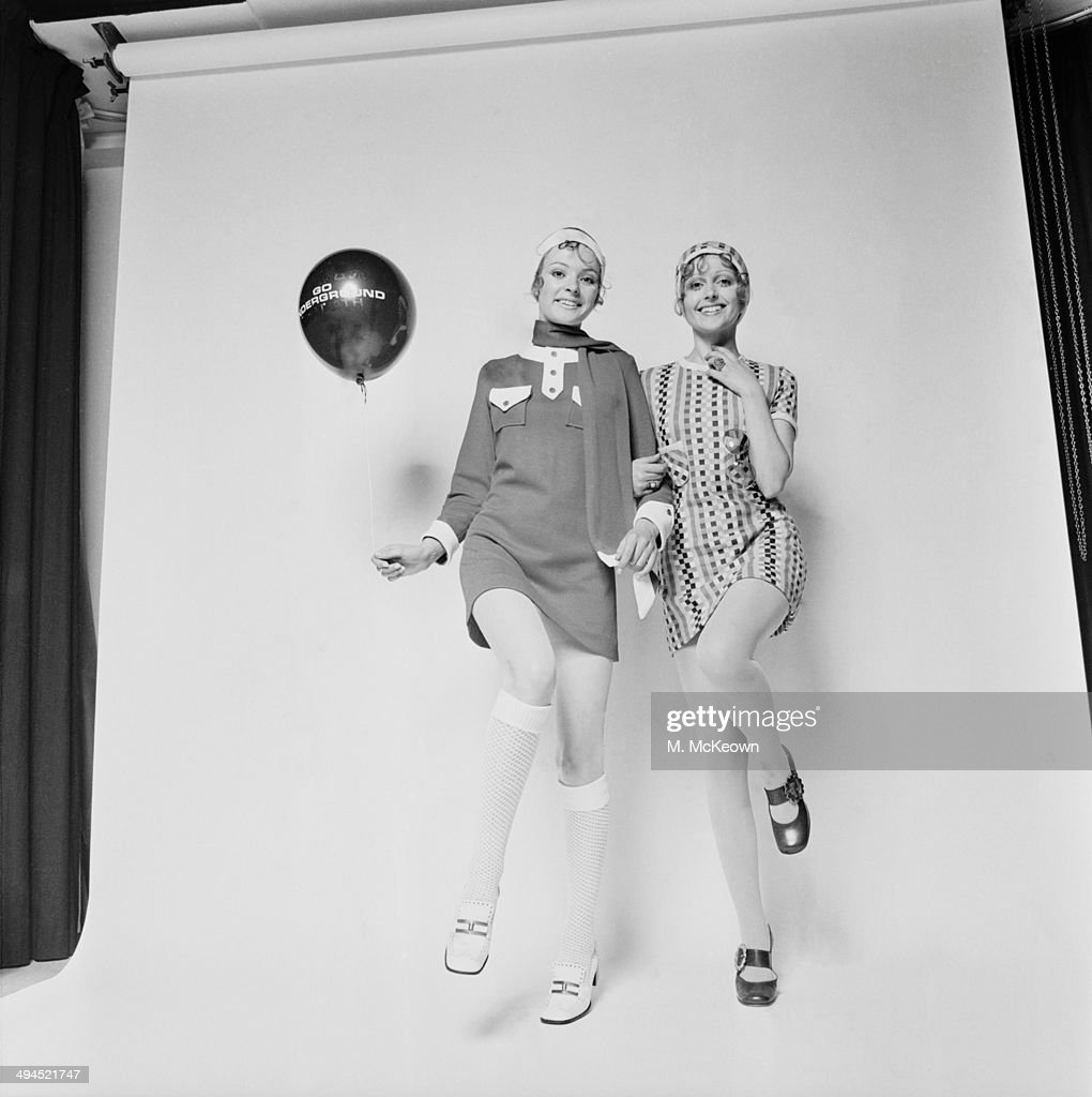 Models Jane O'Leary and Robina Lake wearing respectively a wool jersey dress with matching scarf and cap and a courtelle dress with matching cap UK...