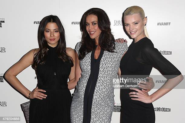 Models Jessica Gomes Megan Gale and Montana Cox pose as they arrive for the 2014 Virgin Australia Melbourne Fashion Festival Opening Event presented...