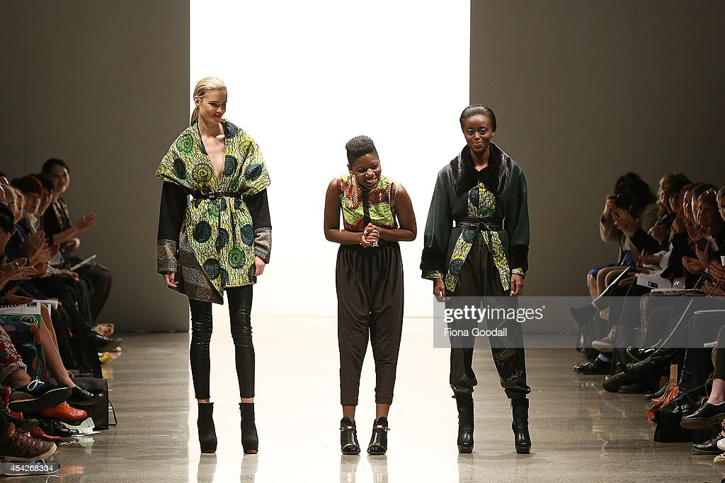 Models join Designer Nomsa Mabuto (C) to thank the crowd in the New Generation Show at New Zealand Fashion Week 2014 on August 28, 2014 in Auckland, New Zealand.