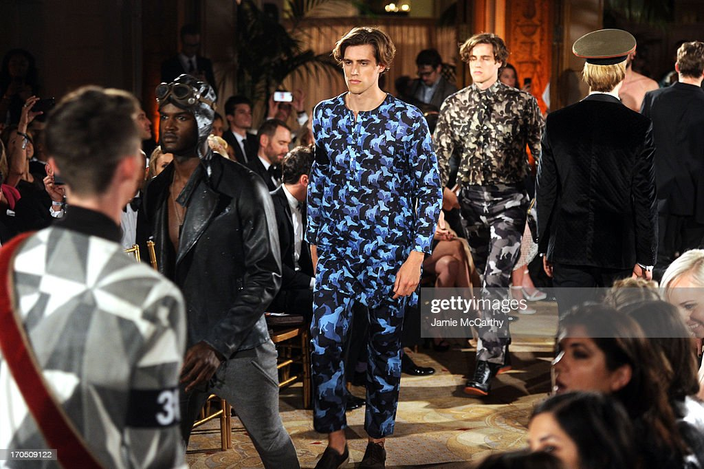 Models Jordan Stenmark and Zac Stenmark walk the runway during the 4th Annual amfAR Inspiration Gala New York at The Plaza Hotel on June 13, 2013 in New York City.