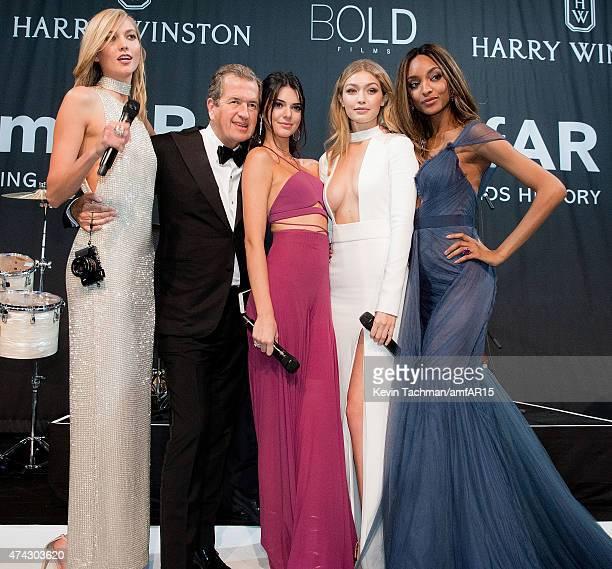 Models Karlie Kloss Kendall Jenner photographer Mario Testino models Gigi Hadid and Jourdan Dunn stand onstage dinner for the amfAR 22nd Annual...