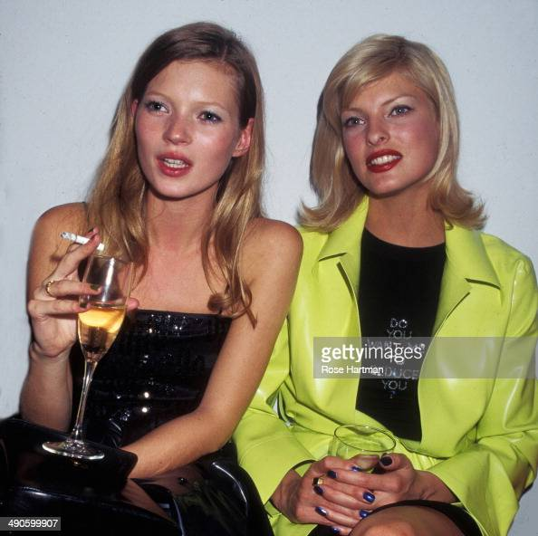 Models Kate Moss and Linda Evangelista attend an Allure Magazine party in a Soho loft New York New York 1994