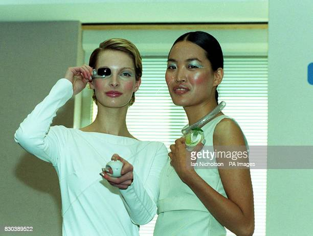 Models Kate Orr wearing a Charmed Communicator and Gloria Wong wearing an Aromabadge at the launch of the Brave New Unwired World fashion technnology...