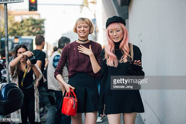 Models Katie Moore and Fernanda Ly wear Alexander Wang after the Ermanno Scervino show during Milan Fashion Week Spring/Summer 2017 on September 24...