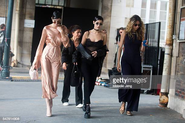 Models Kendall Jenner and Bella Hadid exit the Givenchy show during Paris Fashion Week Men's SS17 on June 24 2016 in Paris France Bella carries a...
