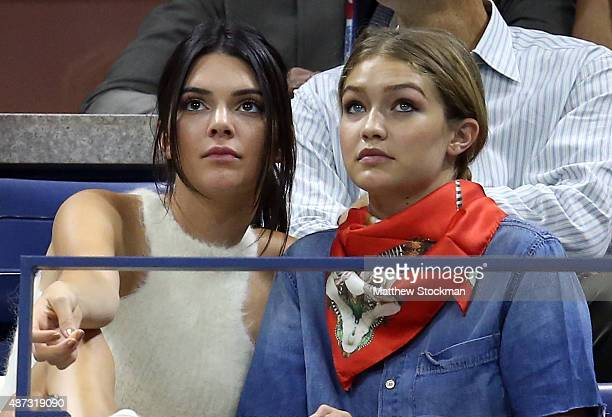 Models Kendall Jenner and Gigi Hadid attend the Women's Singles Quarterfinals match between Serena Williams of the United States and Venus Williams...