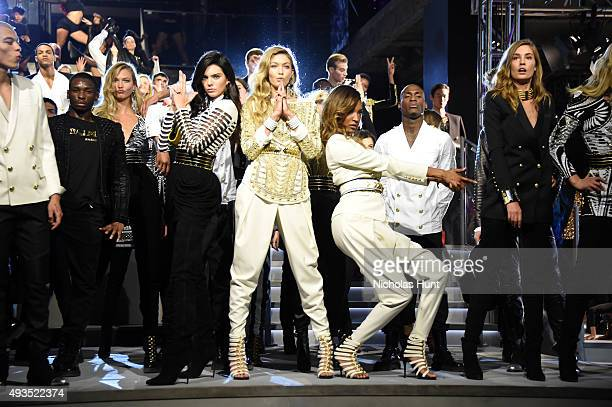 Models Kendall Jenner Gigi Hadid and Jourdan Dunn pose on the runway with other models at the BALMAIN X HM Collection Launch at 23 Wall Street on...