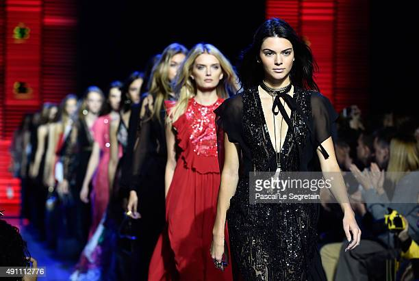 Models Kendall Jenner Lily Donaldson and Gigi Hadid walk the runway during the Elie Saab show as part of the Paris Fashion Week Womenswear...