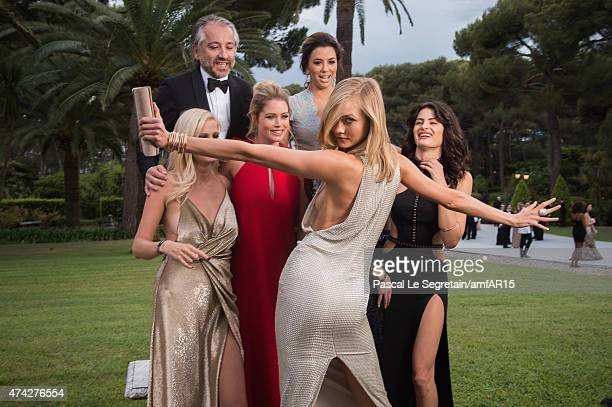 Models Lara Stone Doutzen Kroes President of l'Oreal Cyril Chapuy Actress Eva Longoria Models Karlie Kloss and Isabeli Fontana attend amfAR's 22nd...