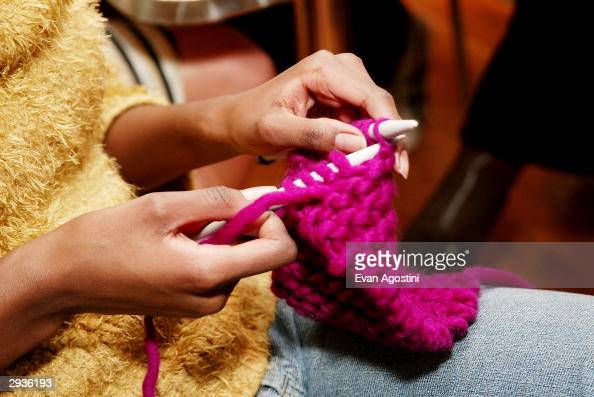 Models learn how to knit at a knitting party hosted by IMG Models at Knit New York February 5 2004 in New York City