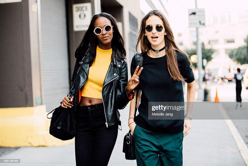 Models Leila Nda and Waleska Gorczevski exit the Derek Lam show at Skylight Clarkson Sq on September 13 2015 in New York City Leila throws a peace...