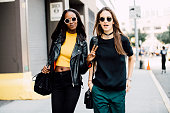 Models Leila Nda and Waleska Gorczevski exit the Derek Lam show at Skylight Clarkson Sq on September 13 2015 in New York City Leila throws a peace...