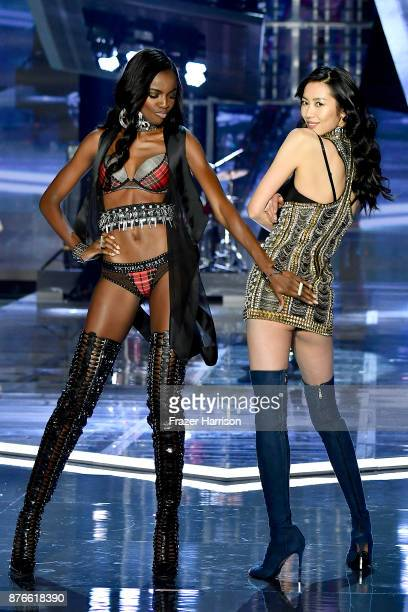 Models Leomie Anderson and Liu Wen walk the runway during the 2017 Victoria's Secret Fashion Show In Shanghai at MercedesBenz Arena on November 20...