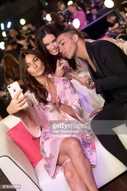 Models Lily Aldridge Adriana Lima and Fashion Designer Olivier Rousteing pose in Hair Makeup during 2017 Victoria's Secret Fashion Show In Shanghai...
