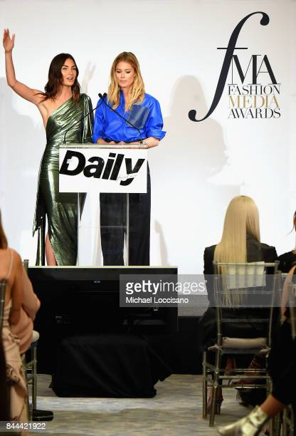 Models Lily Aldridge and Doutzen Kroes present an award onstage during the Daily Front Row's Fashion Media Awards at Four Seasons Hotel New York...