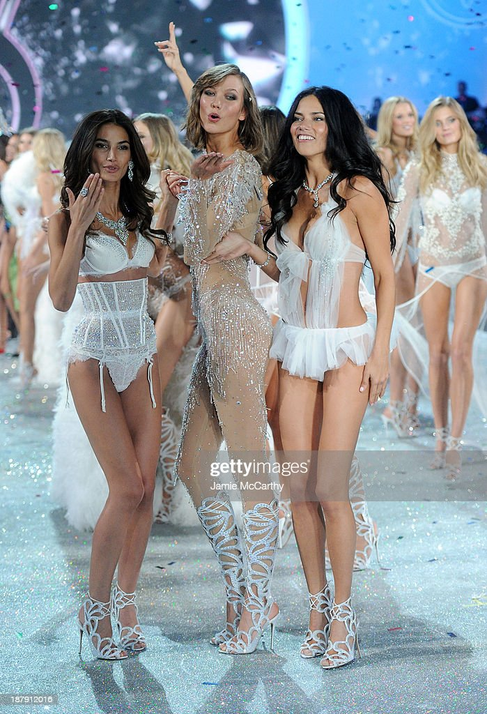 Models <a gi-track='captionPersonalityLinkClicked' href=/galleries/search?phrase=Lily+Aldridge&family=editorial&specificpeople=2110490 ng-click='$event.stopPropagation()'>Lily Aldridge</a>, <a gi-track='captionPersonalityLinkClicked' href=/galleries/search?phrase=Karlie+Kloss&family=editorial&specificpeople=5555876 ng-click='$event.stopPropagation()'>Karlie Kloss</a> and <a gi-track='captionPersonalityLinkClicked' href=/galleries/search?phrase=Adriana+Lima&family=editorial&specificpeople=182444 ng-click='$event.stopPropagation()'>Adriana Lima</a> walk the runway at the 2013 Victoria's Secret Fashion Show at Lexington Avenue Armory on November 13, 2013 in New York City.
