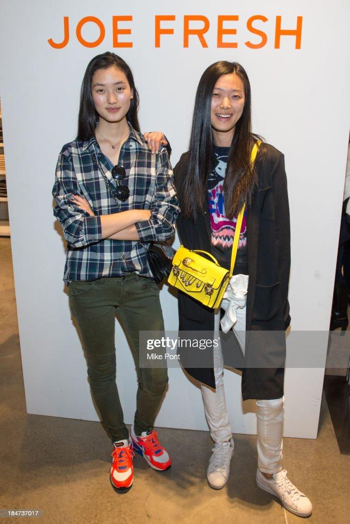 Models Lina Zhang and Tian Yi attend the Joe Fresh Soho opening party at Joe Fresh Soho on October 15 2013 in New York City