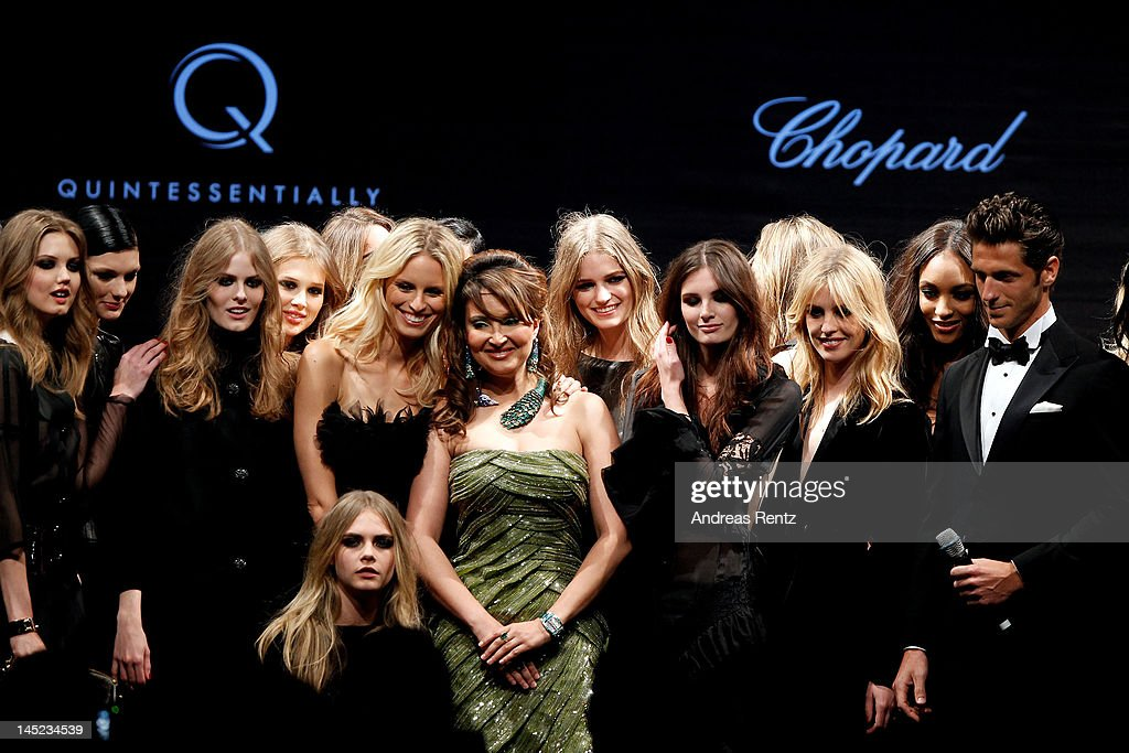 Models Lindsey Wixson (L), Saskia de Brauw (2L), Cara Delevingne (front), Karolina Kurkova (5L) and Jourdan Dunn (2R) pose onstage during the 2012 amfAR's Cinema Against AIDS during the 65th Annual Cannes Film Festival at Hotel Du Cap on May 24, 2012 in Cap D'Antibes, France.