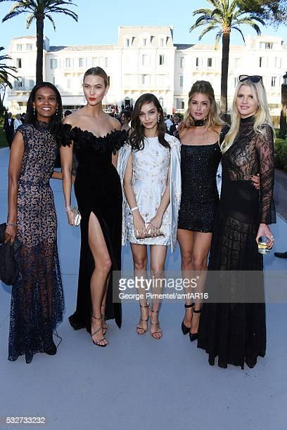 Models Liya Kebede Karlie Kloss Luma Grothe Doutzen Kroes and Lara Stone attend the amfAR's 23rd Cinema Against AIDS Gala at Hotel du CapEdenRoc on...