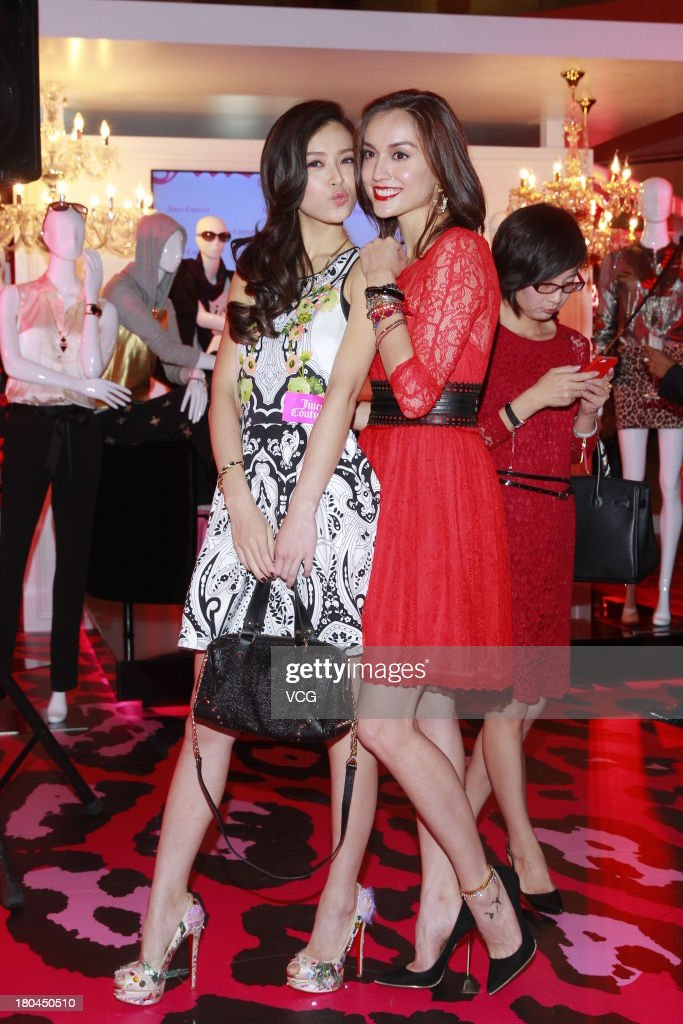 Models Mandy Lieu (R) and <a gi-track='captionPersonalityLinkClicked' href=/galleries/search?phrase=Janice+Man&family=editorial&specificpeople=5814398 ng-click='$event.stopPropagation()'>Janice Man</a> attend Juicy Couture promotional event on September 12, 2013 in Hong Kong, Hong Kong.