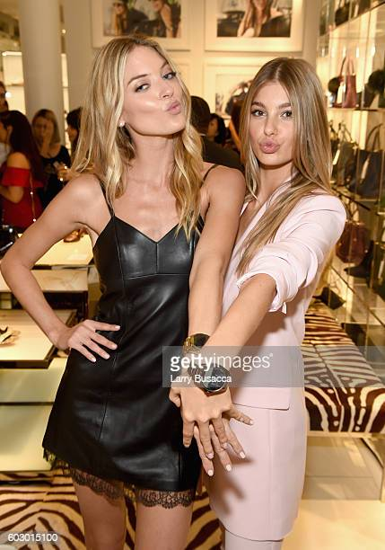 Models Martha Hunt and Cami Morrone attend the Michael Kors Access Smartwatch launch party at Michael Kors on September 11 2016 in New York City