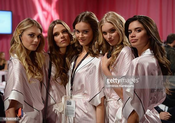 Models Martha Hunt Caroline Brasch Monika Jagaciak Elsa Hosk and Sara Sampaio prepare at the 2013 Victoria's Secret Fashion Show hair and makeup room...
