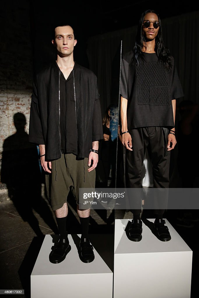 ((L-R) Models Max Von Isser and Jordun Love pose at the Chapter Presentation during New York Fashion Week: Men's S/S 2016 at Industria Superstudio on July 13, 2015 in New York City.